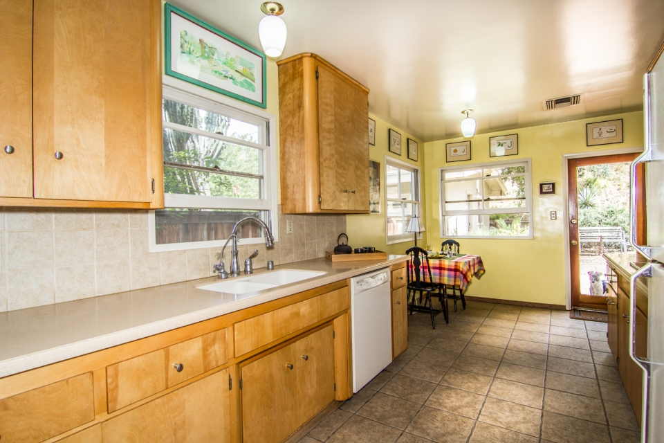 The Kitchen features updated counters and beautiful cabinetry.